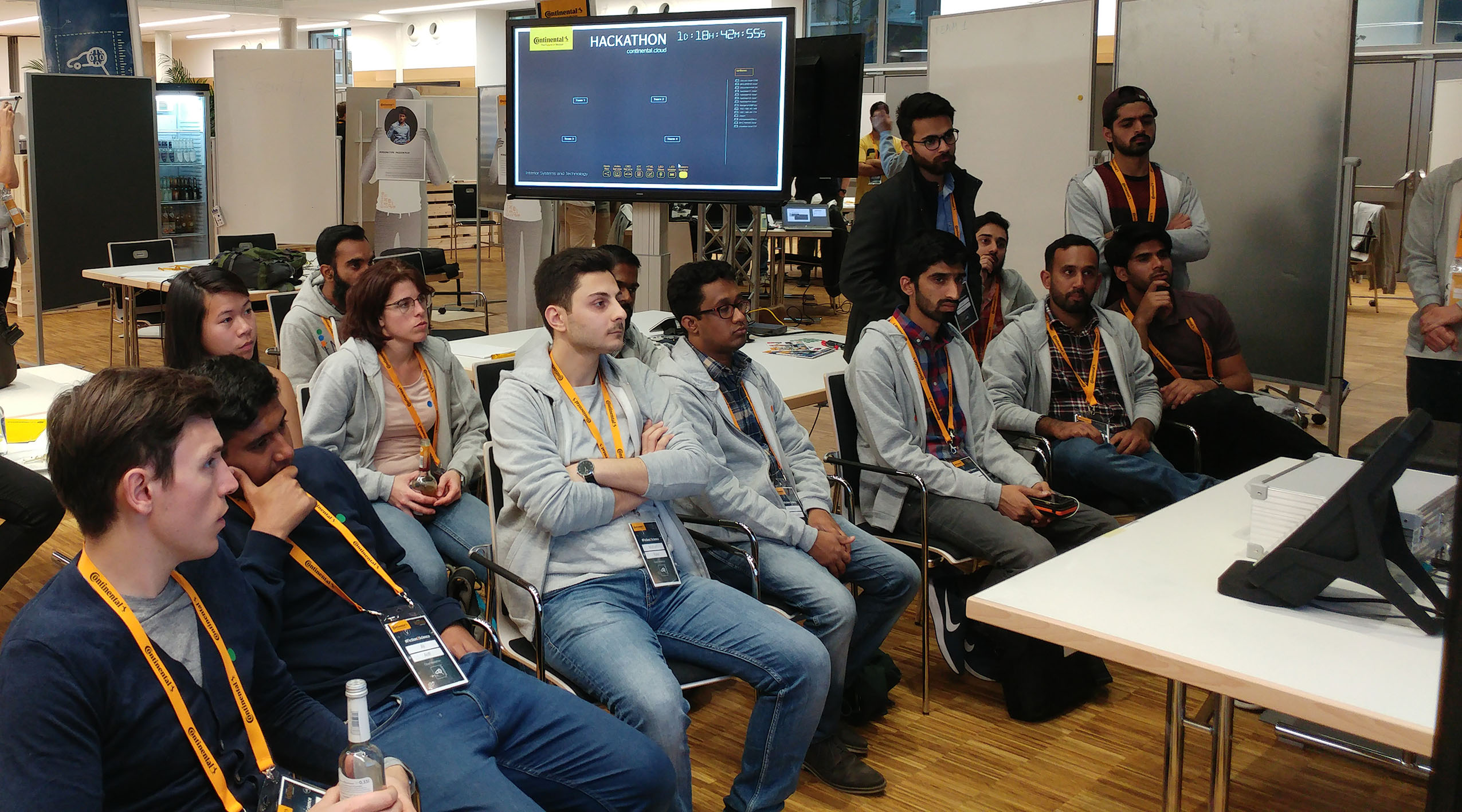 photo of the hackathon participants, sitting and listening to the initial instructions